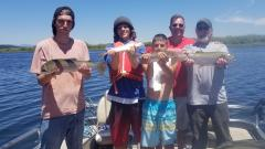 Landing giant Redband trout on Upper Klamath Lake in Klamath Falls Oregon.